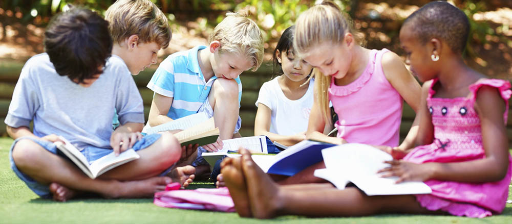 k-1-reading-outdoors